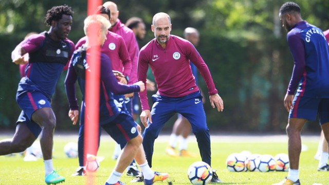 INVOLVED: Pep Guardiola gets stuck in!