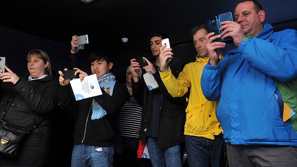ATTRACTING INTEREST: Fans snap the new badge at it's preview in December 2015