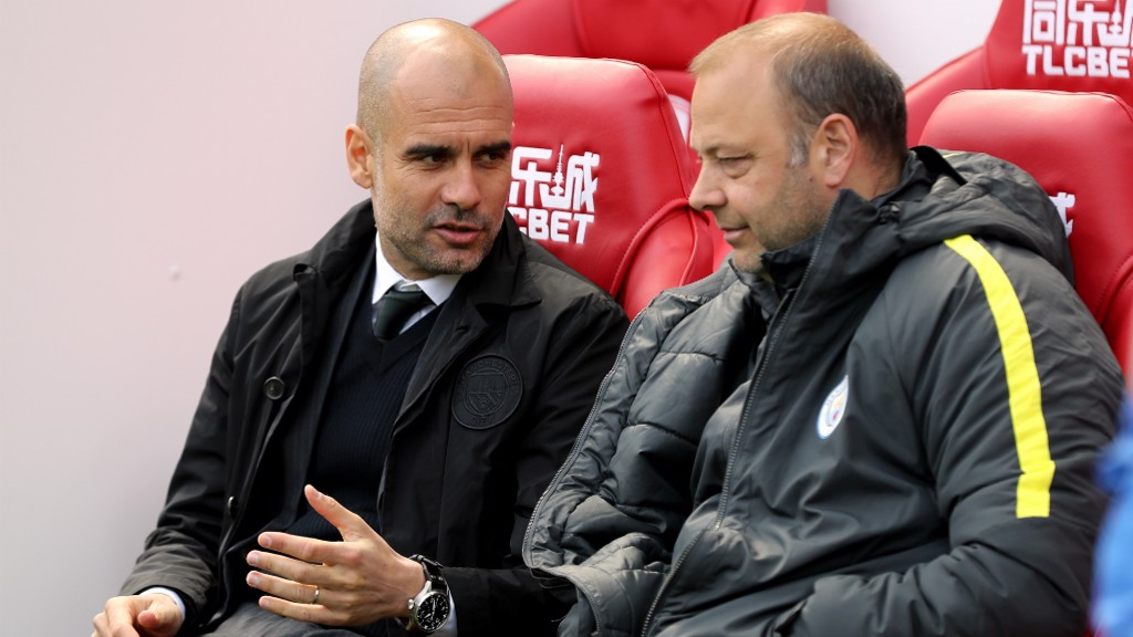 DEEP IN DISCUSSION: Pep consoles with Rodolfo Borrell in the away dugout.