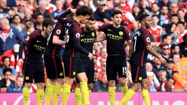 TOGETHER: Aguero celebrates with team-mates as City restore their lead.