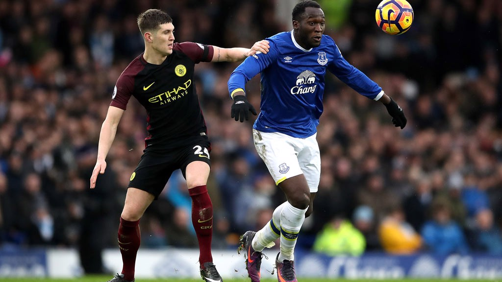 COMPETE - John Stones competes for the ball
