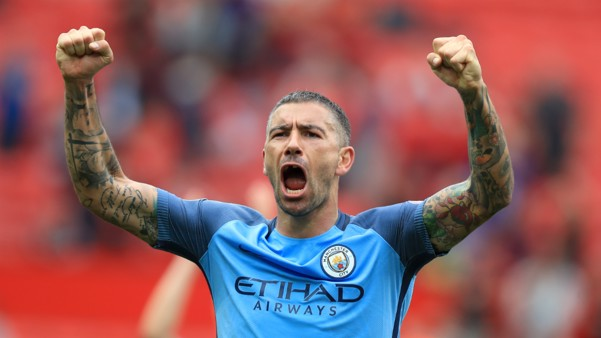 PASSION: A delighted Aleks Kolarov celebrates with the City fans at the final whistle