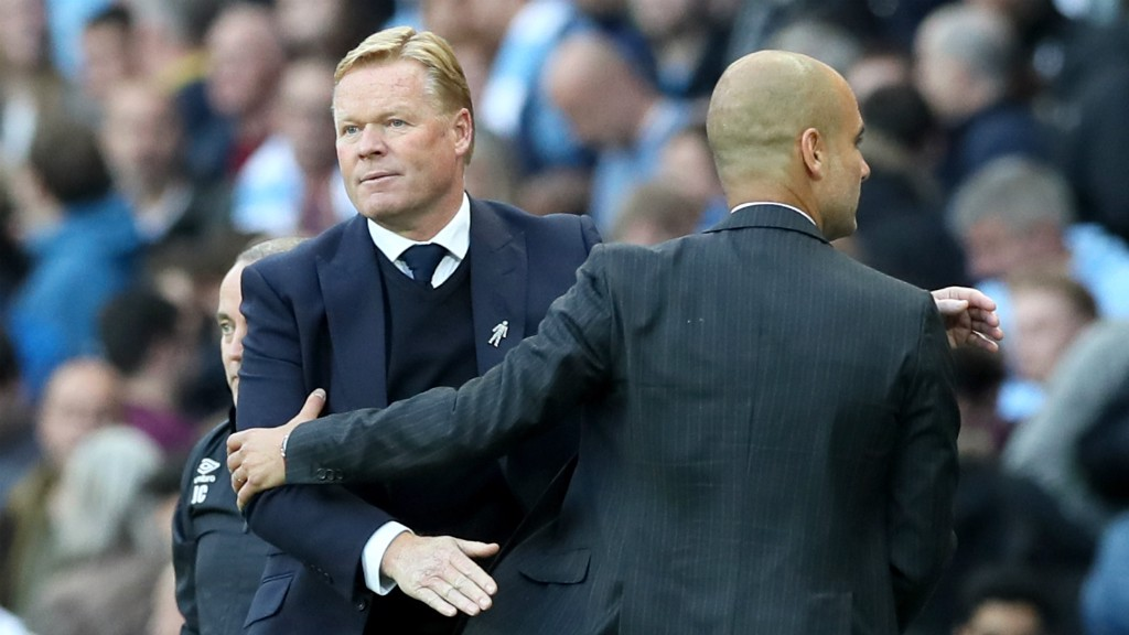 OLD FRIENDS: Pep Guardiola and Ronald Koeman embrace following a 1-1 draw at the Etihad Stadium