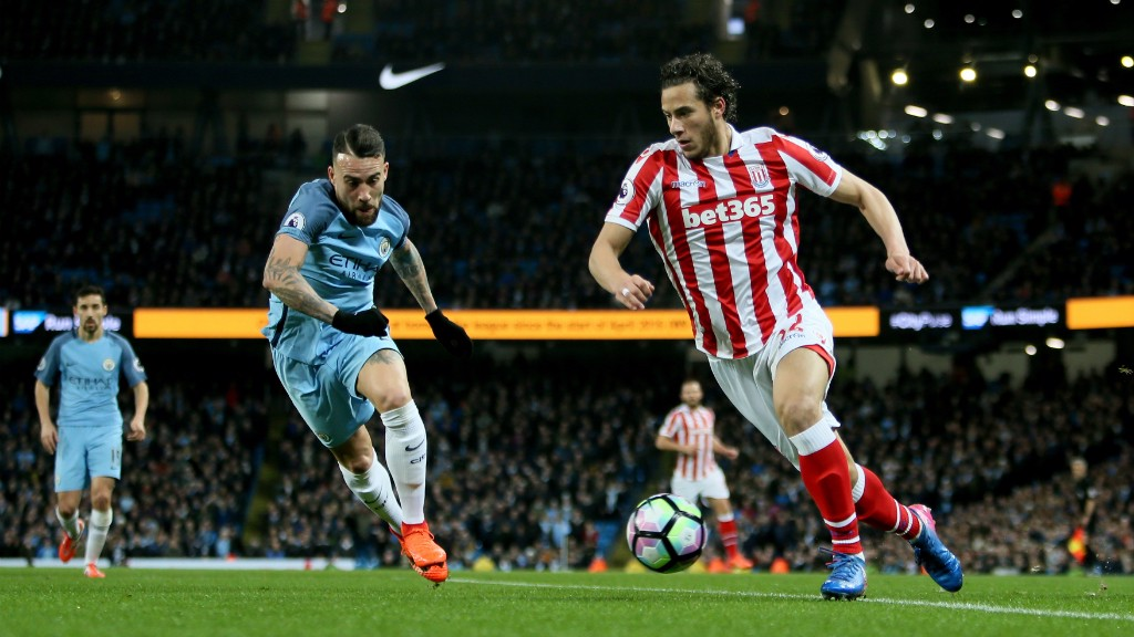 A CLOSE EYE: Nicolas Otamendi looks to get a block in on Ramadan Sobhi's cross.