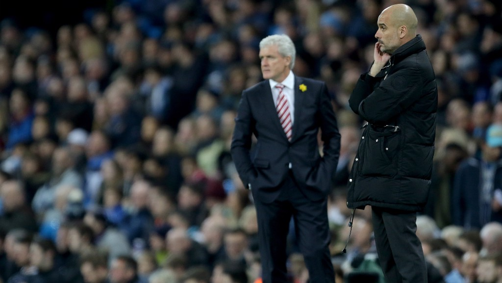 WATCHING ON: Pep and his opposite number, Mark Hughes, keep a close eye on proceedings.