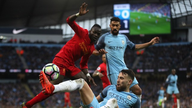 TIMING: Otamendi knicks the ball from Mane.