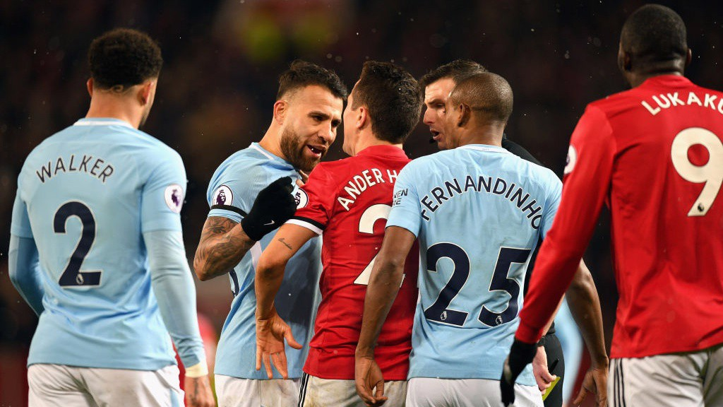 HEATED: The narrow scoreline sees tempers flare at Old Trafford.