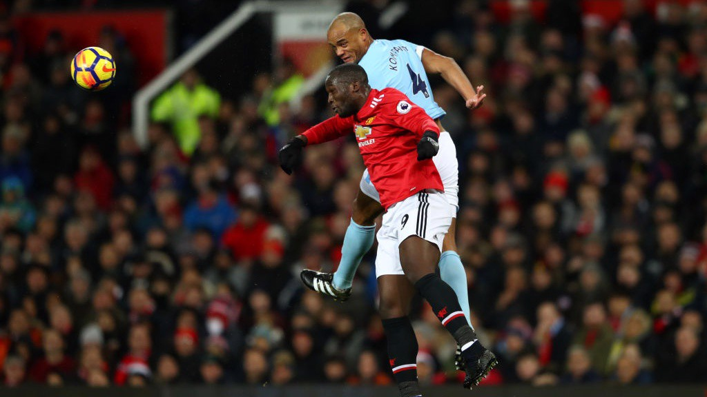 KEY BATTLE: Vincent Kompany gets the better of Romelu Lukaku in a first-half aerial duel.