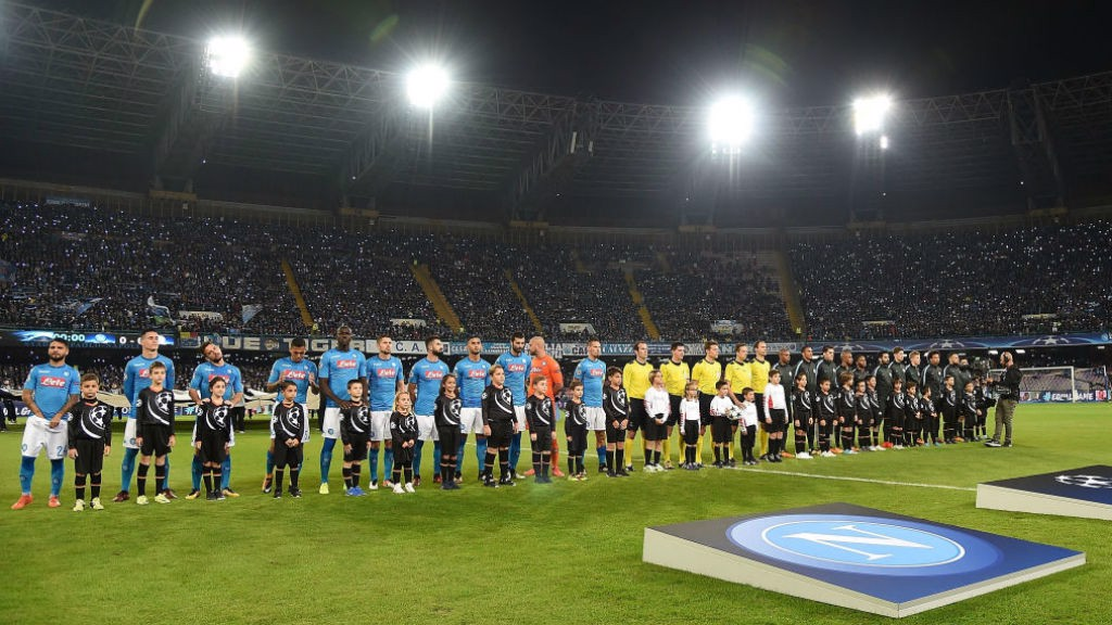 ACTION STATIONS: The teams line up ahead of the kick-off