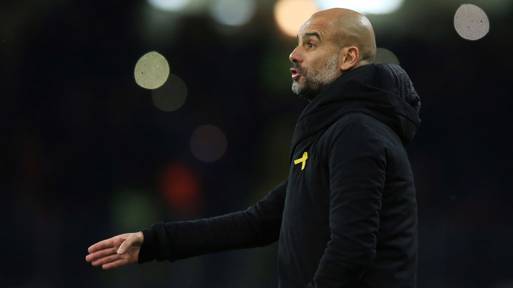 PEP WATCH: The manager observes from the touchline on his 100th Champions League game as a manager.
