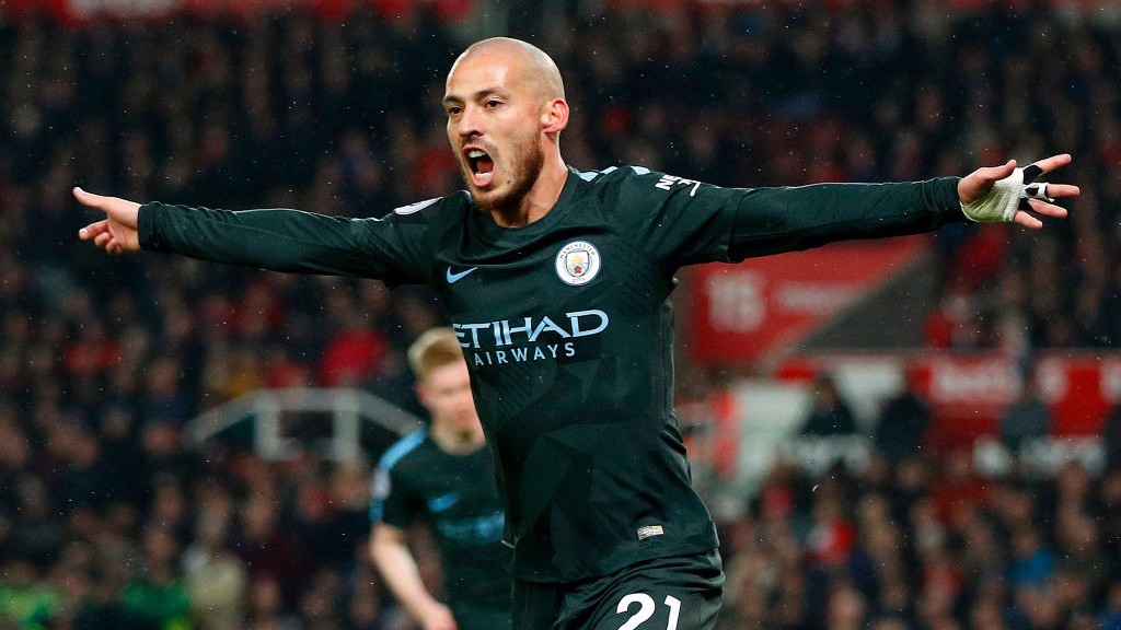MAIN MAN: David Silva celebrates firing City into the lead.