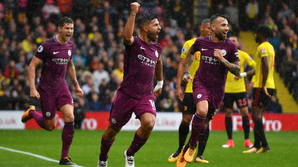 ALL SMILES: Sergio Aguero wheels away in delight after his opening goal