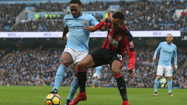 IN BATTLE: Raheem Sterling shields the ball from Bournemouth's Junior Stanislas.