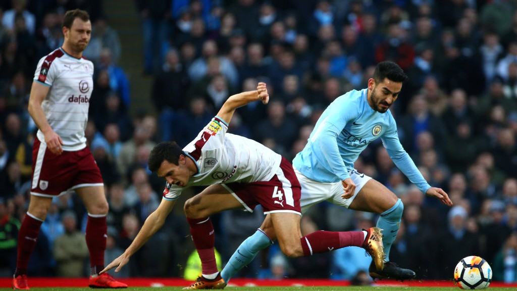 MIDFIELD MAESTRO: Ilkay Gundogan gets the better of Burnley's Jack Cork.