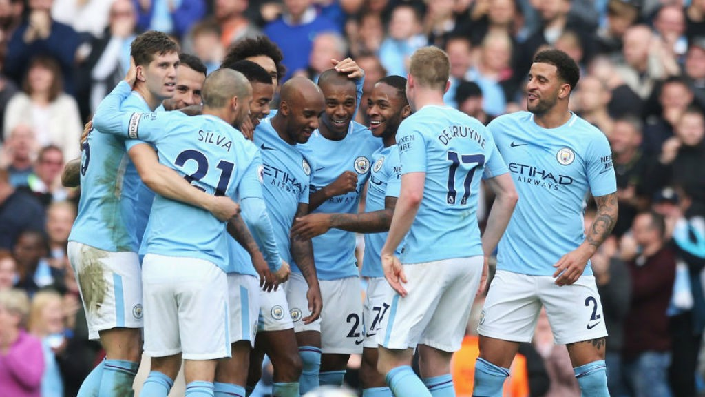 BRAZILIAN BLEND: The City players celebrate after Fernandinho's stunner