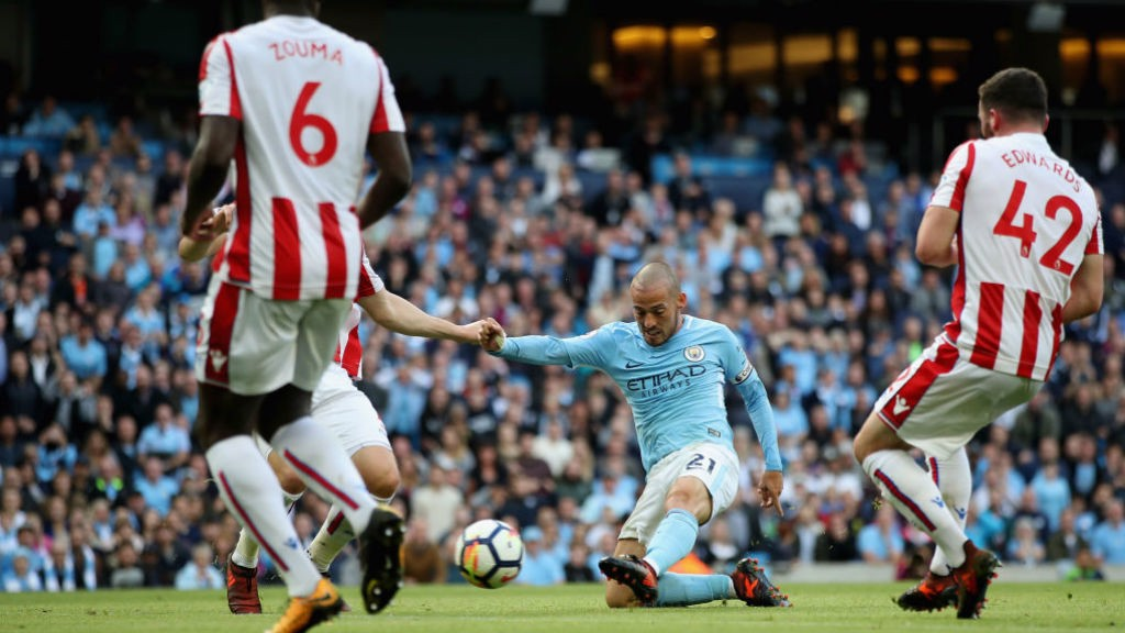 TAKE THAT: David Silva drills home City's third goal
