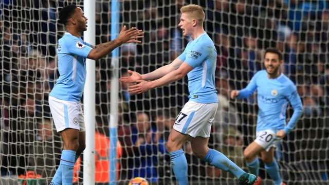 CENTURY: ...Before slotting home for City's 100th goal of the campaign.
