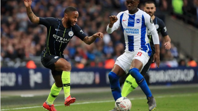 UP AND AT 'EM: Raheem Sterling takes on Brighton's Yves Bissouma