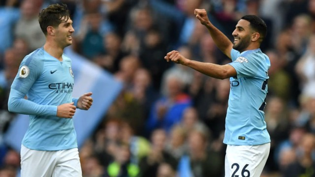 ALL SMILES: Riyad Mahrez celebrates with John Stones after his stunning strike