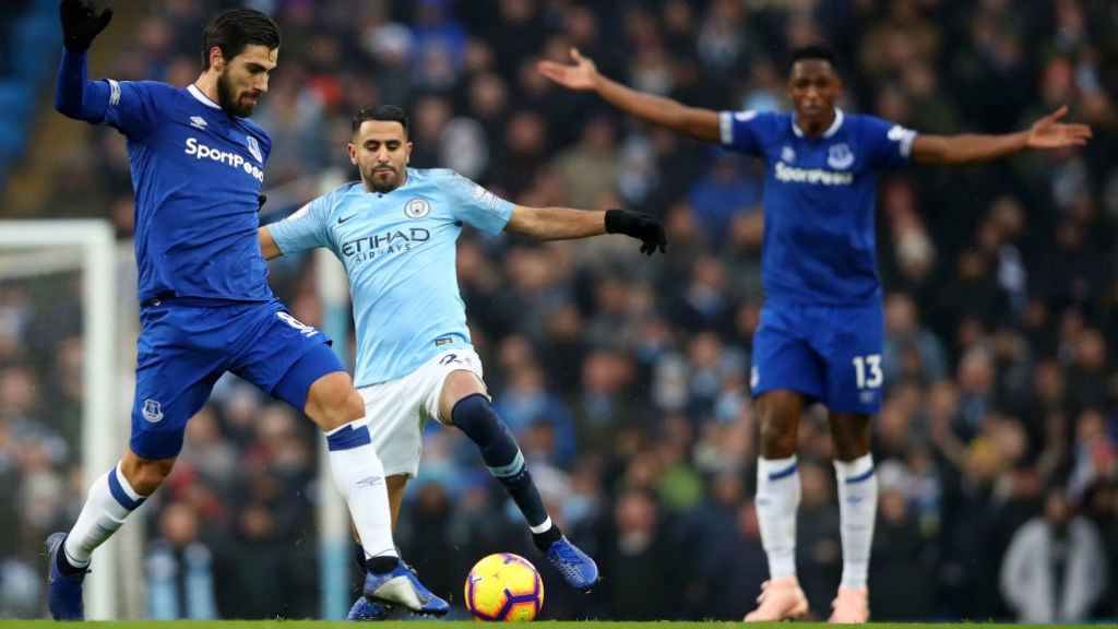 FULL STRETCH: Riyad Mahrez looks to dispossess Andre Gomes