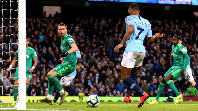 TWO'S COMPANY: Raheem slots home his and City's second goal after great work by David Silva and Riyad Mahrez