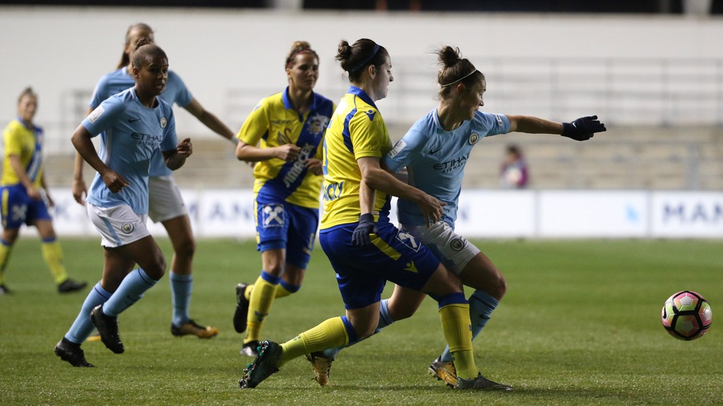 MOVEMENT: Jane Ross escapes the attentions of two defenders