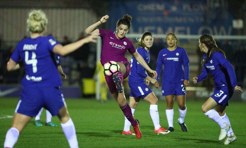 STEADY: Jen Beattie calmly gets the ball under control, watched on by four Chelsea players