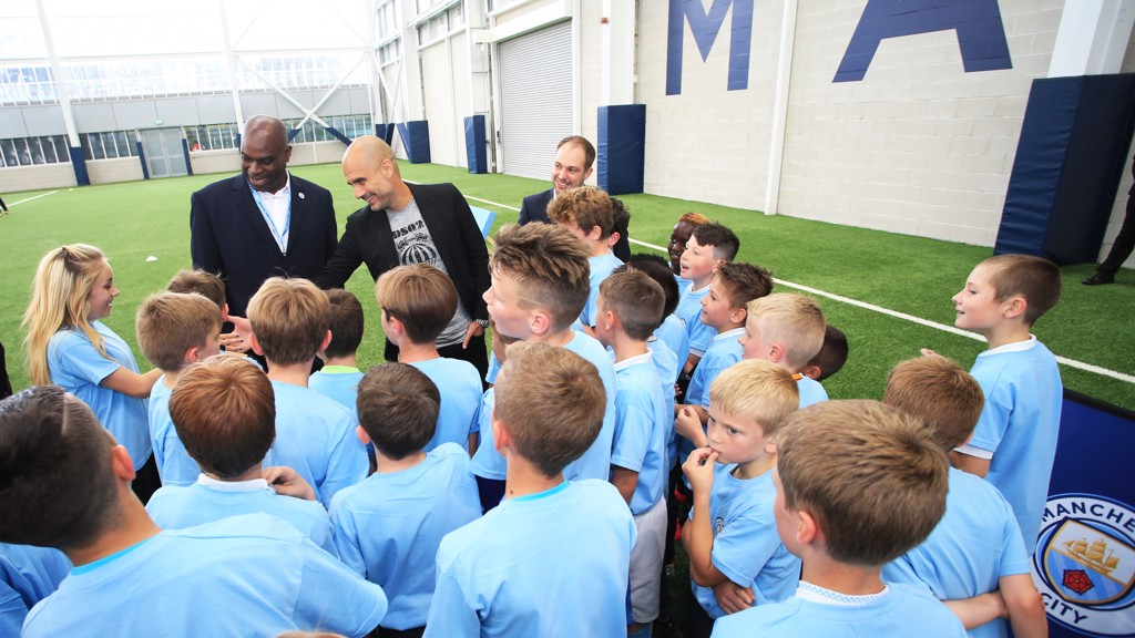 Pep Guardiola Alex Williams CITC Ambassador and Mike Green Head of CITC welcome local youngsters to the CFA