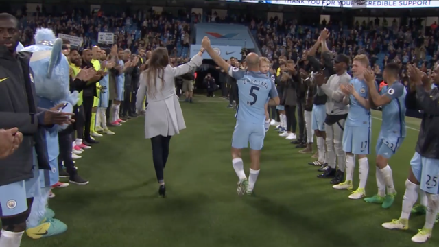 TUNNEL CAM: The players give Pablo Zabaleta a guard of honour, while the fans stand to applaud