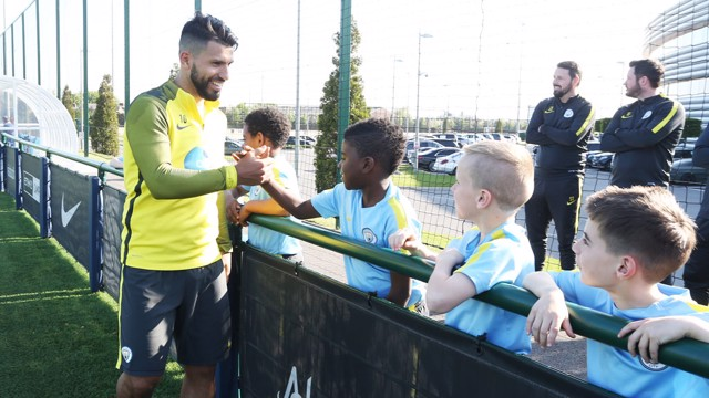 MEETING YOUR HEROES: Sergio Aguero shakes hands with some of the U8s academy team