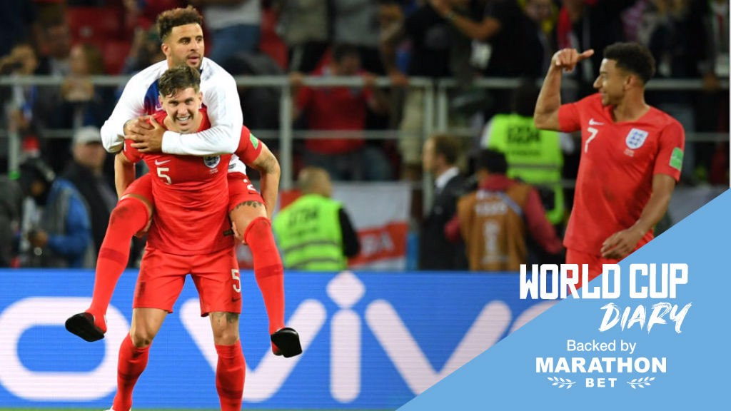 WORLD IN MOTION: John Stones and Kyle Walker celebrate a famous England victory