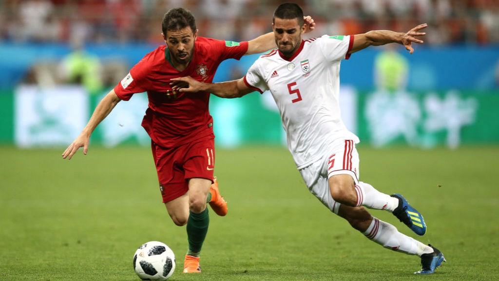 WORLD IN ACTION: Bernardo Silva vies for possession during Portugal's final group game against Iran