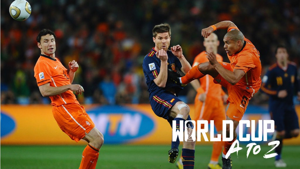 FLASHPOINT: Nigel de Jong of the Netherlands challenges Spain's Xabi Alonso during the 2010 World Cup final