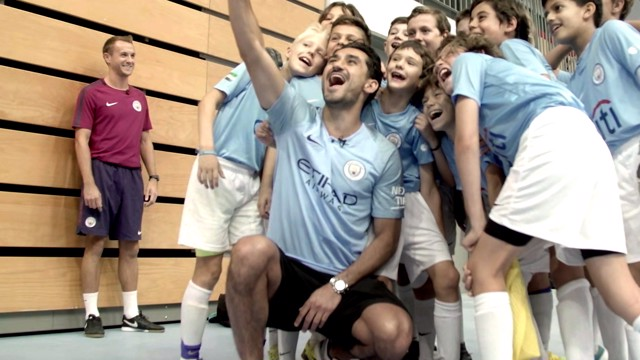 NOTHING WITHOUT YOU: Ilkay Gundogan surprised a group of young players at the City Football School in Abu Dhabi